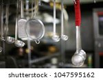variety of kitchen supplies | Shutterstock . vector #1047595162