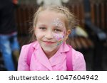 young girl blonde with pigtails.... | Shutterstock . vector #1047604942