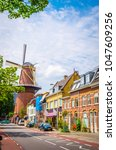 traditional old mill and houses ... | Shutterstock . vector #1047609256