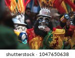 man with a mask at religious... | Shutterstock . vector #1047650638