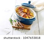 baked pork ribs with cabbage... | Shutterstock . vector #1047653818