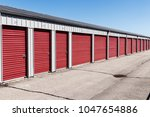 numbered self storage and mini... | Shutterstock . vector #1047654886