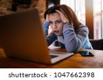frustrated worried young woman... | Shutterstock . vector #1047662398