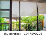 white curtains or roller blind... | Shutterstock . vector #1047690208