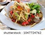 papaya salad is a spicy food . | Shutterstock . vector #1047724762