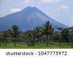 merapi volcano landscape  java  ... | Shutterstock . vector #1047775972