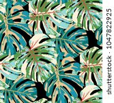 tropical leaves. seamless... | Shutterstock .eps vector #1047822925