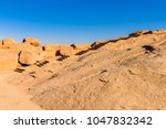 nature around ancient ruins... | Shutterstock . vector #1047832342