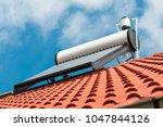 solar water heater on roof top  ...   Shutterstock . vector #1047844126