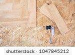 wooden floor installation | Shutterstock . vector #1047845212