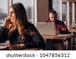a young freelancer works at a... | Shutterstock . vector #1047856312