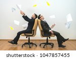 the two men sit on chairs and... | Shutterstock . vector #1047857455