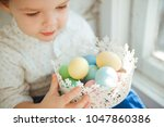 the little boy holds in his... | Shutterstock . vector #1047860386