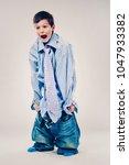 caucasian boy wearing his dad's ... | Shutterstock . vector #1047933382