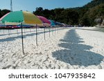 colorful sunshades on the beach | Shutterstock . vector #1047935842