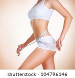 woman measuring her waistline.... | Shutterstock . vector #104796146