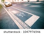 bicycle sign on street | Shutterstock . vector #1047976546