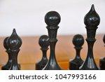 chessmen on the board   Shutterstock . vector #1047993166
