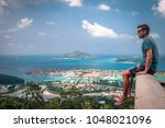 seychelles  young man high in... | Shutterstock . vector #1048021096
