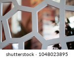 white decorative perforated... | Shutterstock . vector #1048023895