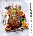 roast goose with pears  red... | Shutterstock . vector #1048057678