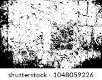 stone block wall surface. black ... | Shutterstock .eps vector #1048059226