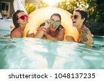 three women friends enjoying... | Shutterstock . vector #1048137235