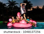 man standing on inflatable... | Shutterstock . vector #1048137256