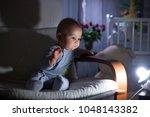 little baby boy  sitting in... | Shutterstock . vector #1048143382