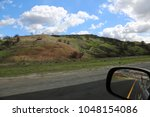 car driving on a highway | Shutterstock . vector #1048154086