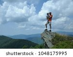 father hold her daugher in his... | Shutterstock . vector #1048175995