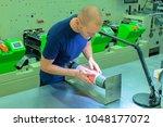 worker in print factory ... | Shutterstock . vector #1048177072