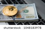 bitcoin coin with laptop and us ... | Shutterstock . vector #1048183978