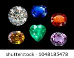 mix bright gems isolated on ... | Shutterstock . vector #1048185478