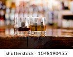 whiskey drinks on rustic bar... | Shutterstock . vector #1048190455