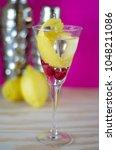 raspberry lemon vodka martini...   Shutterstock . vector #1048211086