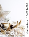 antler candle with pine cones...   Shutterstock . vector #1048216606