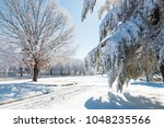 winter season in city  road and ... | Shutterstock . vector #1048235566