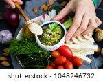 woman hand adds sesame seeds to ... | Shutterstock . vector #1048246732
