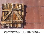 old wood window closed on... | Shutterstock . vector #1048248562