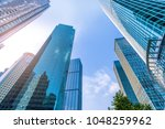 urban building skyscrapers | Shutterstock . vector #1048259962