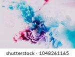 blue and red splash on white... | Shutterstock . vector #1048261165