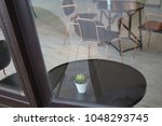 outside the coffee shop view... | Shutterstock . vector #1048293745