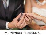 Close Up Groom Put The Wedding...