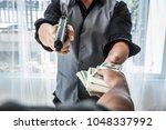 gun and money in a hands. bank...