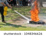 demonstration of the fire with... | Shutterstock . vector #1048346626