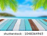 wooden table on summer beach... | Shutterstock . vector #1048364965