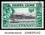 """SIERRA LEONE - CIRCA 1940: Depicting city scene and an inset of King George VI, with inscription """"Freetown from the Harbour"""", circa 1940 - stock photo"""