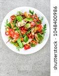 fresh vegetable salad plate of... | Shutterstock . vector #1048400986