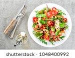 fresh vegetable salad plate of... | Shutterstock . vector #1048400992